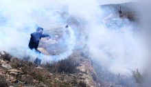 "Residents of Nabi Saleh marched  together with international activists, calling for Palestinian unity in the face of the ongoing occupation. The Israeli army attempted to suppress the march firing barrages of tear gas canisters and spraying foul-smelling liquid from its ""skunk"" truck. No major injuries reported."