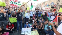 "Palestinian and Jewish activists took over Jaffa's landmark clock tower square to protest the Prawer plan which would displace 30,000 Bedouins in the Naqab / Negev southern region of the country. Protesters chanted ""Prawer will not pass"" and blocked the road for about an hour and a half."