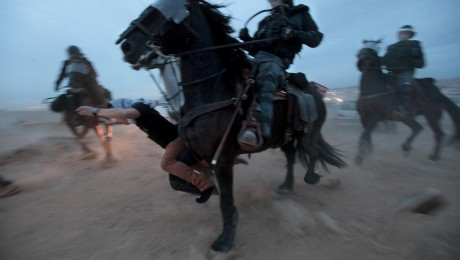 A protester trampled by a mounted policeman, during his arrest at a demonstration against the government's plan to re-settle tens of thousands of Bedouins in the Negev.