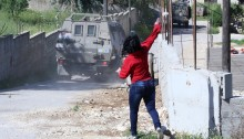 """The local popular resistance committee led the weekly Friday march in the village of Nabi Saleh, accompanied by solidarity activists. Marchers chanted against the occupation and ongoing land annexation, as they proceeded towards the village's main gate. The IDF attempted to disperse the march using tear gas canisters and live (""""tutu"""") ammunition fired by snipers. As a result, two marchers were injured by live bullets, both taken to hospital for treatment. Manal Tamimi suffered a fracture to her leg from a live bullet."""