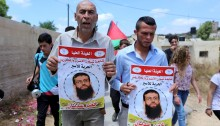 On the first Friday of the holy month of Ramadan, residents of Nabi Saleh staged a demonstration in solidarity with the hunger striking political prisoner, Khader Adnan. Adnan, who already went through a long hunger strike back in 2012 before he was released, launched another hunger strike several weeks ago in protest of the repeated renewal of his administrative detention. Since then, his medical condition has reportedly deteriorated, and he was taken to an Israeli hospital, where he is kept cuffed to his bed. Protesters held banners with Adnan's image and marched with the Palestinian flag. The Israeli soldiers attempted to disperse them by firing rounds of tear gas. No major injuries reported.