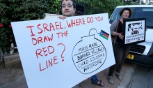 Israeli activists staged a vigil outside the home of the South Sudanese ambassador in Kfar Shmaryahu, where a formal reception was taking place. The activists were protesting the ongoing Israeli arms sales to South Sudan, where a civil war is taking place and there is ample documentation of severe human rights violations.