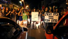 """For the first time, hundreds gathered in Tel Aviv to protest the ongoing exploitation of women in the sex industry, and especially in prostitution. Protesters assembled in Hayarkon street, in front of a building that houses a brothel (dubbed """"discrete apartment""""), where J, a prostitute who was employed there, committed suicide several days ago. Protesters called for an end to brothels, calling their """"clientele"""" rapists for taking advantage of vulnerable women like J and many others. Demonstrators also briefly blocked the street to traffic and one protester was arrested by police."""