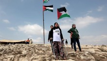 """Residents of Nabi Saleh and solidarity activists staged the weekly march towards the al-Qaws spring, which was expropriated by the settlers from nearby Halamish in 2009. This weekly demonstrations began after the settlers took over the spring and adjoining lands owned by Nabi Saleh and Deir Nizam, renamed the site """"Maayan Meir"""" and with the assistance of the IDF, blocked Palestinians from using the spring. In 2013, the Israeli supreme court ordered the settlers to cease any further works in the site and the immediate dismantling of existing structures. Nevertheless, the IDF still prohibits the Palestinian owners from reaching their lands. On the first Friday of October 2015, settlers staged a demonstration, marching from Halamish to the spring as a show of force, under military protection, while Palestinians were forced to watch from the opposite hill."""