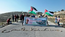 Commemorating the village's martyrs Mustafa and Rushdi Tamimi, activists from Nabi Saleh marched from the village's main square towards the main road and the checkpoint. Four years ago, Mustafa Tamimi, 28, was shot and killed by an Israeli soldiers who was sitting inside an armored vehicle and aimed his weapon directly at Tamimi's head. The village's wonam spelled Mustafa's name with stones, and then some of the children proceeded towards the main gate with footballs. The Israeli soldiers targeted the children with tear gas canisters. They were also using new and improved tear gas launchers that has a much bigger range. In addition, the soldiers also fired rubber-coated steel bullets, injuring several protesters.