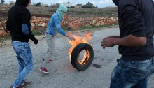 "Palestinian protesters of the village of Nabi Saleh confronted the Israeli army. The demonstration, which began near the local gas station, marched along  the main road towards the checkpoint, where soldiers attempted to disperse protesters with tear gas and rubber coated steel bullets. In addition, schoolchildren from the nearby settlement of Halamish came out, yelling ""death to Arabs"" and other racial slurs."