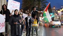 A few dozens of Palestinian activists and Israeli allies staged a protest in Jaffa's historic clock tower square, demanding the Israeli government ordered the immediate cessation of its bombing campaign in the Gaza Strip